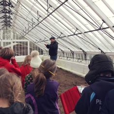 Phil, Head Gardener at Trengwainton explains to Trythall School about the Victorian greenhouse